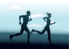 Man and woman running together Stock Image