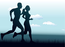 Man and woman running together Royalty Free Stock Images
