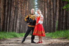 Man and woman in Russian national clothes Stock Photography