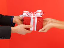 Man and woman's hands with gift box Royalty Free Stock Image