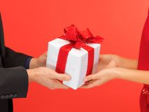 Man and woman's hands with gift box Stock Photos