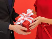 Man and woman's hands with gift box Stock Images