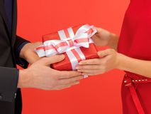 man and woman's hands with gift box Royalty Free Stock Photos