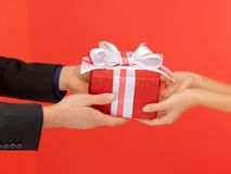 Man and woman's hands with gift box Royalty Free Stock Photo