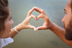 Man and woman's hands in heart shape. Close up of Man and woman's hands in heart shape Stock Image