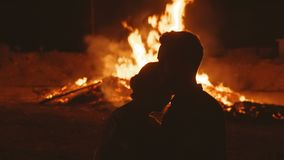 The man and the woman are saddened by the grief of the destruction of the fire. Man and woman saddened by grief from destruction and fire stock footage