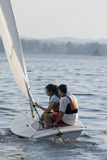 Man and Woman Sailing in Boat on Lake - Vertical Royalty Free Stock Photos