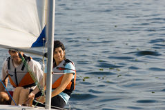 Man and Woman Sailing in Sailboat -Horizontally Stock Image