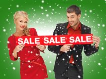 Man and woman with sale sign Stock Image
