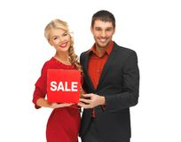 Man and woman with sale sign Stock Photography