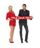 Man and woman with sale sign Stock Photo