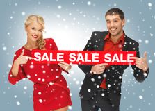 Man and woman with sale sign Royalty Free Stock Image
