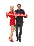 Man and woman with sale sign Royalty Free Stock Photo