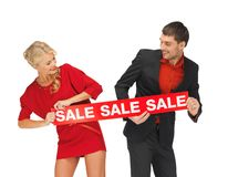 Man and woman with sale sign Stock Images