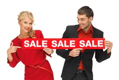 Man and woman with sale sign Royalty Free Stock Images