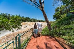 Man and woman on the Saltos del Monday in Paraguay. stock photos