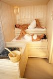 Man and woman in sauna. Man and women lying in sauna, relaxing on wellness Royalty Free Stock Photography