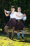 Man and woman in scottish costume Stock Photos