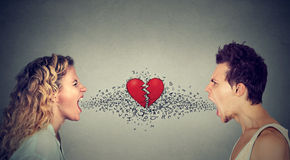 Man woman screaming at each other alphabet broken heart in-between Stock Photos