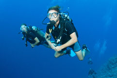 Man and woman scuba dive togeather Royalty Free Stock Photography