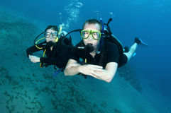 Man and woman scuba diver Stock Images