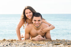 Man and woman on sea background Stock Images