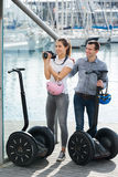 Man and woman with segways Royalty Free Stock Photo