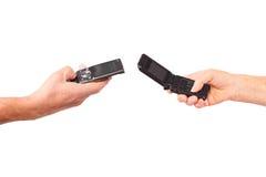 Man, woman senior hands hold mobile phones Stock Photos
