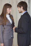 Man and woman shaking hands Stock Images