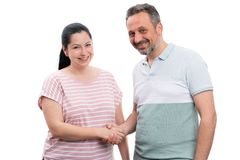 Man and woman shaking hands. Man and women shaking hands as greeting or deal concept isolated on white studio background royalty free stock photography