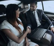 Man and woman shaking hands in car Stock Photos