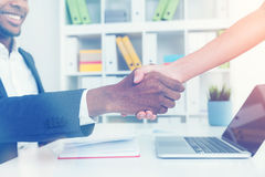Man and woman shaking hands in office Royalty Free Stock Photography
