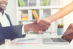 Man and woman shaking hands in the office stock photos