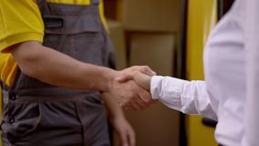 Man and Woman shaking hands. Outdoor.