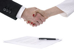 Man and woman shaking hands over a contract Royalty Free Stock Photo