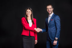 Man and woman shaking hands Stock Photos