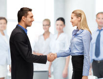 Man and woman shaking their hands Royalty Free Stock Photo