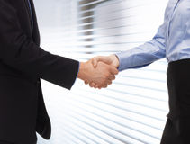 Man and woman shaking their hands Stock Image