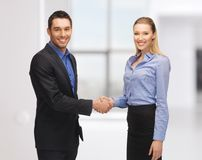 Man and woman shaking their hands Stock Photos