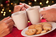 Man and Woman Sharing Hot Chocolate and Cookies Royalty Free Stock Photo