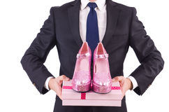 Man with woman shoes isolated on white. Man with  woman shoes  on white Stock Photography