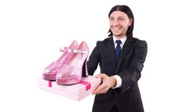 Man with woman shoes isolated on white. Man with woman shoes isolated on the white Stock Images