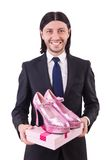 Man with woman shoes isolated on the white. Man with woman shoes isolated on white Royalty Free Stock Images