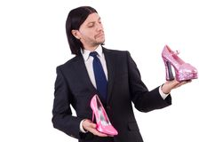 Man with woman shoes isolated on the white. Man with woman shoes isolated on white Stock Image