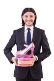Man with woman shoes isolated on the white Royalty Free Stock Photography