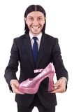 Man with woman shoes isolated on the white. Man with woman shoes isolated on white Royalty Free Stock Photography