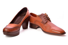 Man and woman shoes. Picture of Brown man and woman Shoes on white Stock Photography