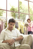 Man and Woman in Shop Stock Photo