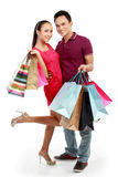 Man and woman with shopping bag. Full lenght portrait of happy couple carrying shopping bag on white background Royalty Free Stock Photos