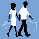 Man and woman with shopping bags Stock Photos